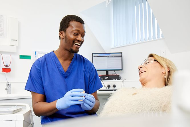 Dentist discusses treatment with patient